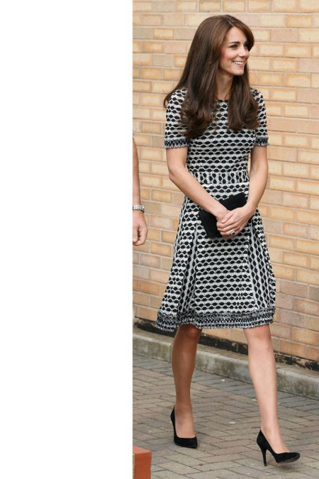 Tory Burch dress with simple black pumps and a clutch